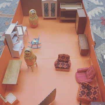 Fill a small box with furniture to make an orange doll's house